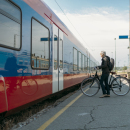 Cyclist boarding a train